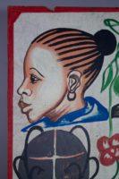 Painted by Joel in Adjame, Abidjan, 4 women's heads on a white background, upper left portrait