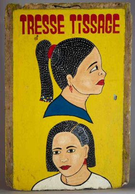 Large double sided commercial art sign advertising the Tresse Tissage beauty salon with 2 women's heads on each side, yellow background, better side