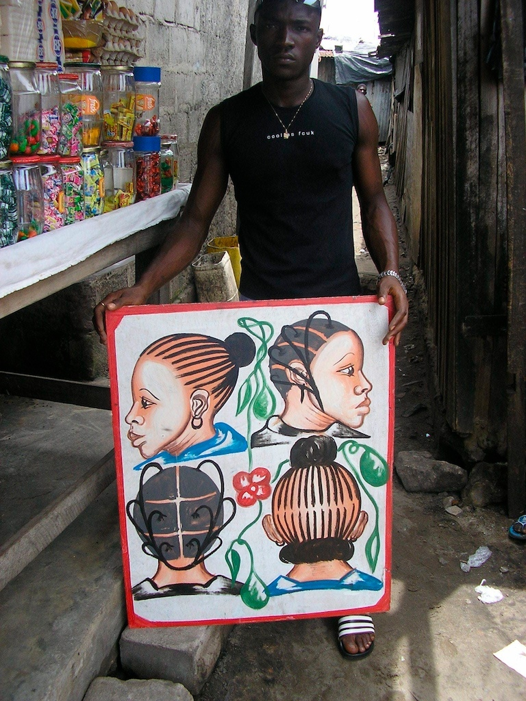 Painted by Joel in Adjame, Abidjan, 4 women's heads on a white background, man for perspective