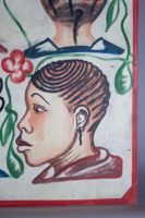 Painted by Joel in Adjame, Abidjan, 4 women's heads on a white background, lower right portrait