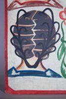 Painted by Joel in Adjame, Abidjan, 4 women's heads on a white background, lower left portrait