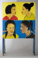 4 women's heads on one side of a sandwich style sign advertising a beauty salon