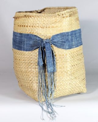 Small handwoven flexible sac style swamp grass basket with indigo textile accent, view A