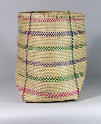 Medium handwoven flexible sac style swamp grass basket with bands of color, view A